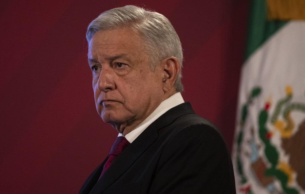 Mexico's President Andres Manuel Lopez Obrador arrives for his daily, morning news conference at the presidential palace, Palacio Nacional, in Mexico ...