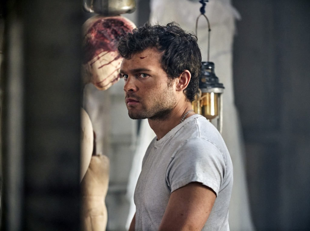 """This image released by Peacock shows Alden Ehrenreich as John the Savage in a scene from the series """"Brave New World,"""" available on the new streaming ..."""