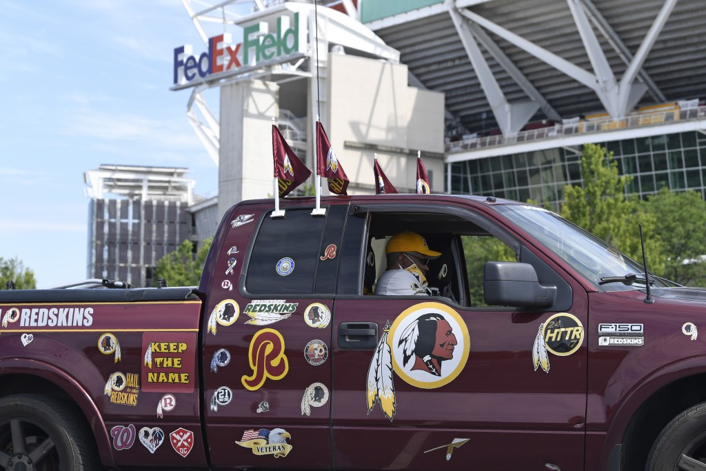 Rodney Johnson of Chesapeake, Va., sits in his truck outside FedEx Field in Landover, Md., Monday, July 13, 2020. The Washington NFL franchise announc...