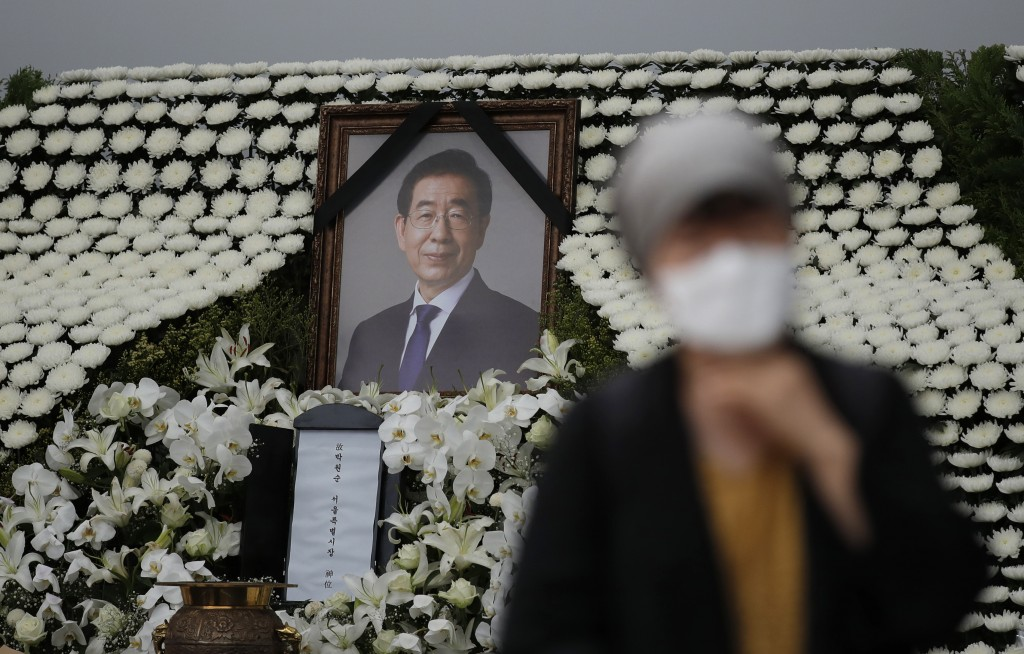 A mourner passes by a memorial altar for late Seoul Mayor Park Won-soon at City Hall Plaza in Seoul, South Korea, Monday, July 13, 2020. Mayor Park wa...