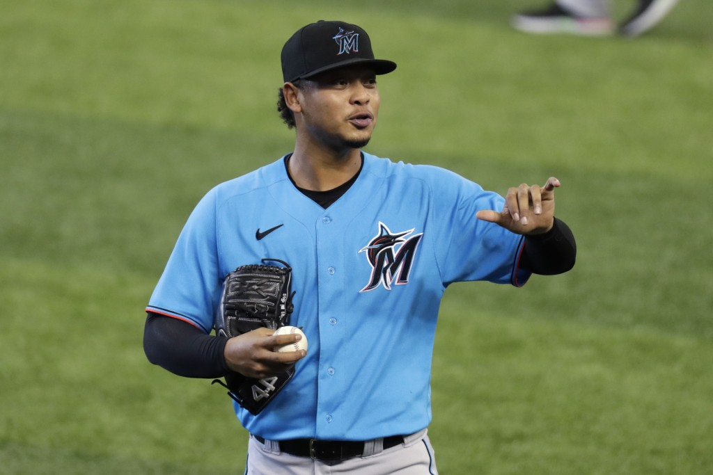 Miami Marlins' Elieser Hernandez gestures after warming up before a baseball scrimmage at Marlins Park, Sunday, July 12, 2020, in Miami. (AP Photo/Lyn...