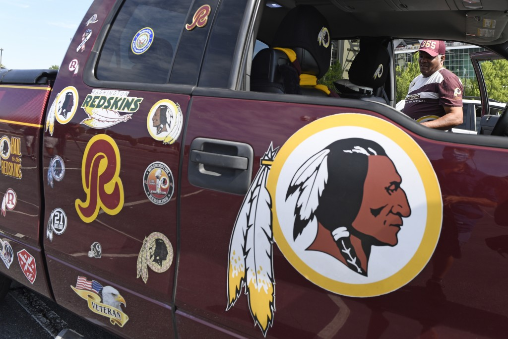 Rodney Johnson of Chesapeake, Va., stands with his truck outside FedEx Field in Landover, Md., Monday, July 13, 2020. The Washington NFL franchise ann...