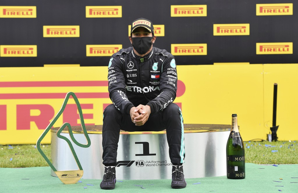 Mercedes driver Lewis Hamilton of Britain sits on the podium after winning the Styrian Formula One Grand Prix at the Red Bull Ring racetrack in Spielb...