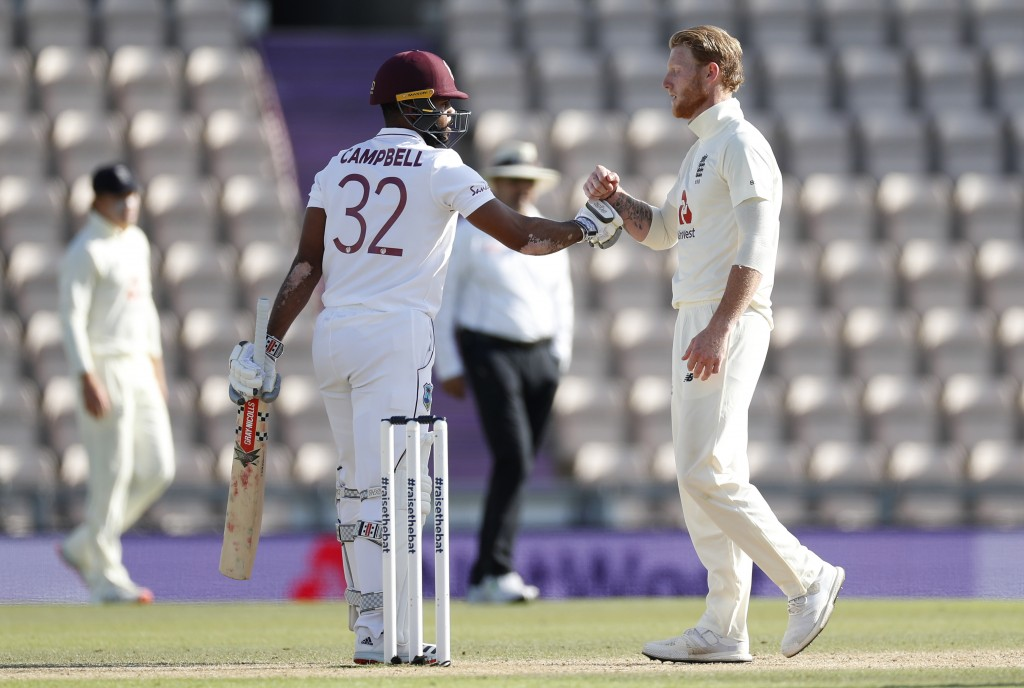 West Indies' John Campbell, left, greets England captain Ben Stokes after winning the first cricket Test match between England and West Indies, at the...