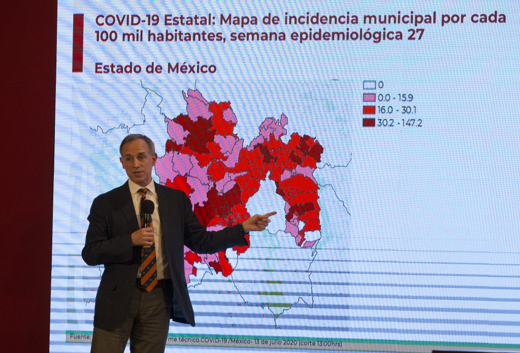 Deputy Health Secretary Hugo Lopez-Gatell speaks during a press conference about the new coronavirus, at the Palacio Nacional in Mexico City, Monday, ...