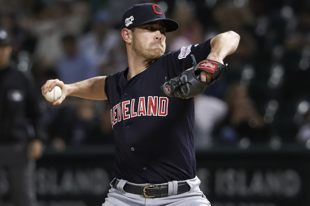 FILE - In this Sept. 25, 2019, file photo, Cleveland Indians starting pitcher Shane Bieber delivers during the first inning of the team's baseball gam...