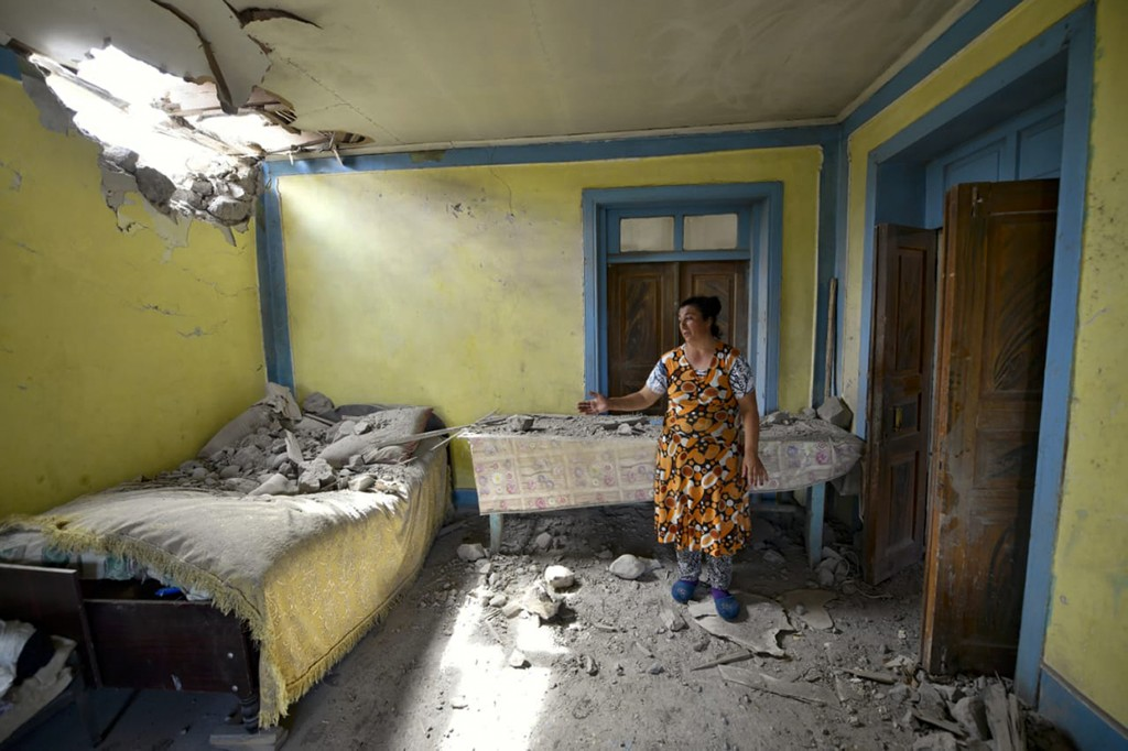 A local woman shows damage in her house after the shelling by Armenian forces in the Tovuz region of Azerbaijan, Tuesday, July 14, 2020. Skirmishes on...