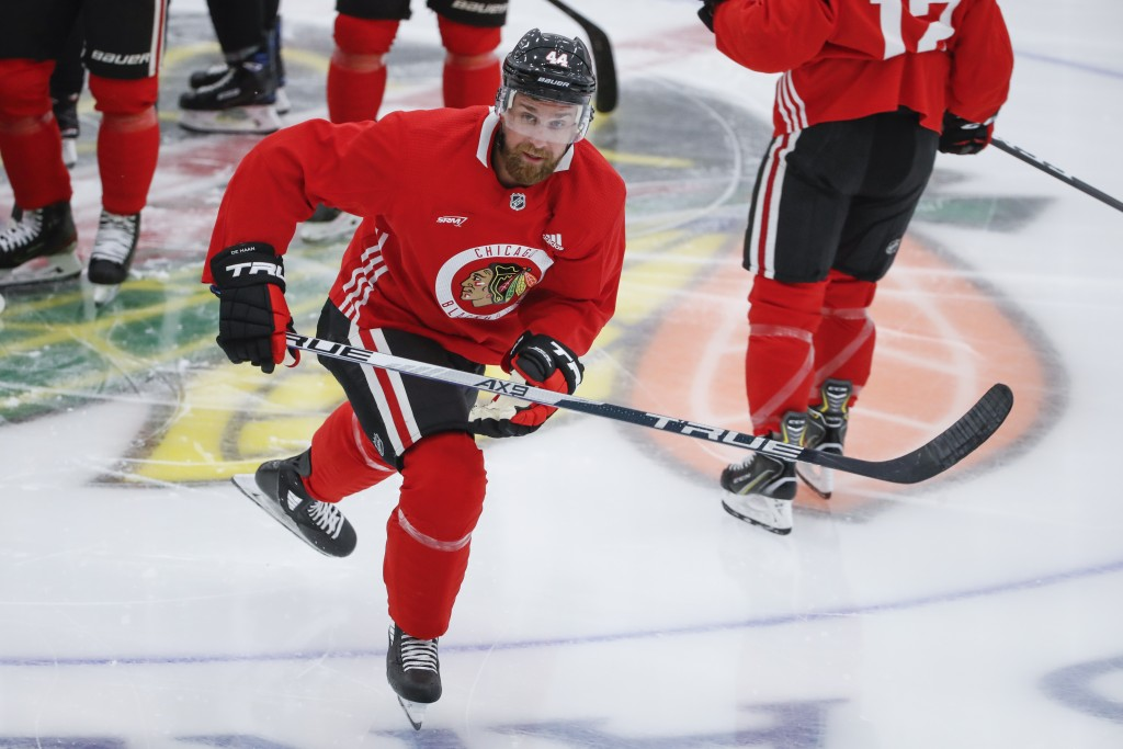 Chicago Blackhawks defenseman Calvin de Haan skates during NHL hockey practice at Fifth Third Arena on Monday, July 13, 2020, in Chicago. (AP Photo/Ka...