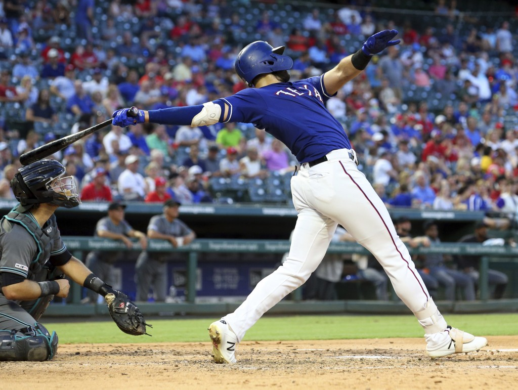 FILE - In this July 16, 2019, file photo, Texas Rangers' Joey Gallo follows through on a solo home run in the fourth inning of a baseball game against...
