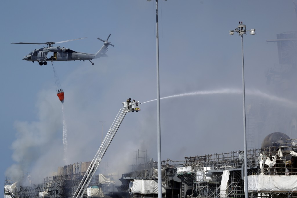 Fire crews battle the fire on the USS Bonhomme Richard, Monday, July 13, 2020, in San Diego. Fire crews continue to battle the blaze Monday after 21 p...