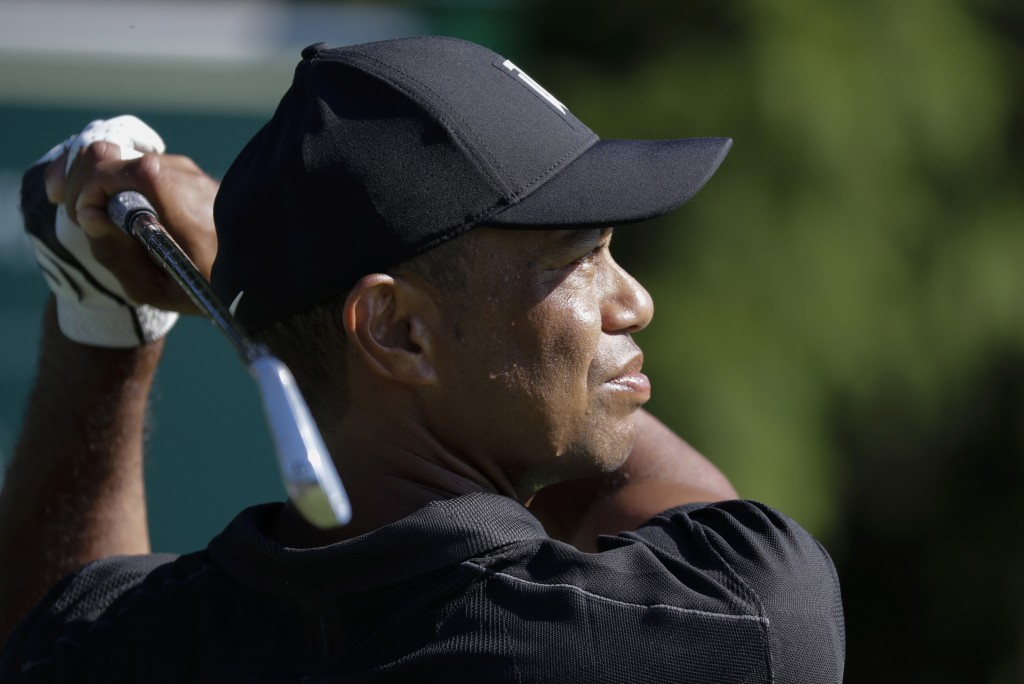 Tiger Woods watches his tee shot on the 14th hole during a practice round for the Memorial golf tournament, Tuesday, July 14, 2020, in Dublin, Ohio. (...