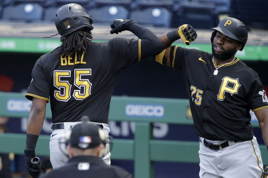 Pittsburgh Pirates' Josh Bell (55) is greeted by Gregory Polanco after hitting a solo home run off pitcher Joe Musgrove during the team's intrasquad b...