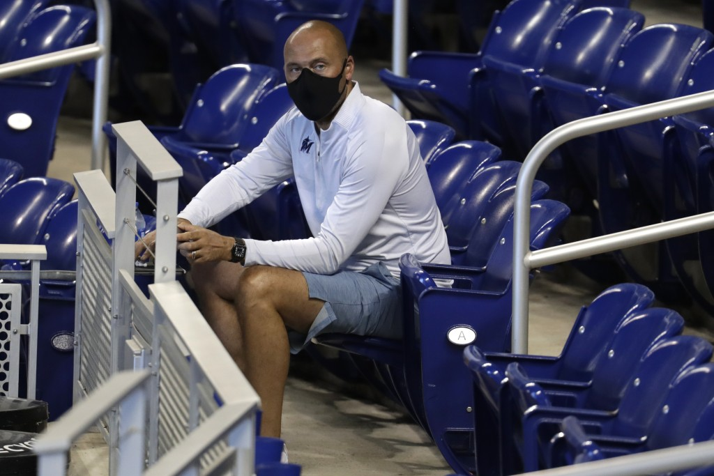 FILE - In this Wednesday, July 8, 2020, file photo, Miami Marlins CEO Derek Jeter watches baseball practice at Marlins Park in Miami. (AP Photo/Lynne ...