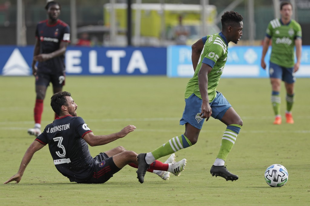 Seattle Sounders defender Kelvin Leerdam, right, moves the ball past Chicago Fire defender Jonathan Bornstein (3) during the first half of an MLS socc...