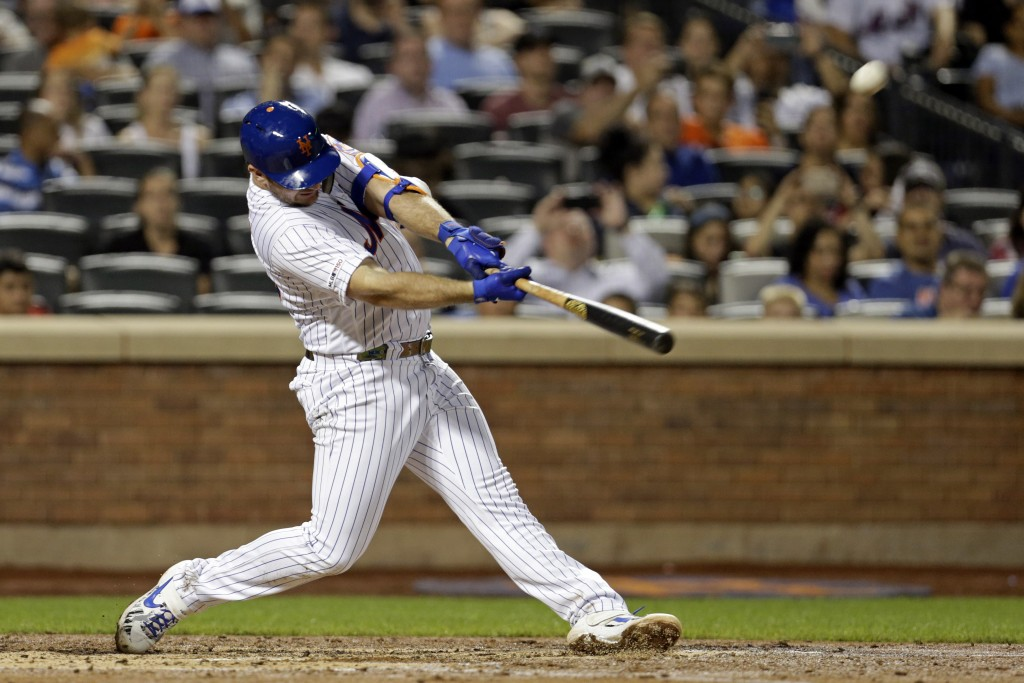 FILE - In this Sept. 28, 2019, file photo, New York Mets' Pete Alonso hits his 53rd home run of the season during the third inning of a baseball game ...