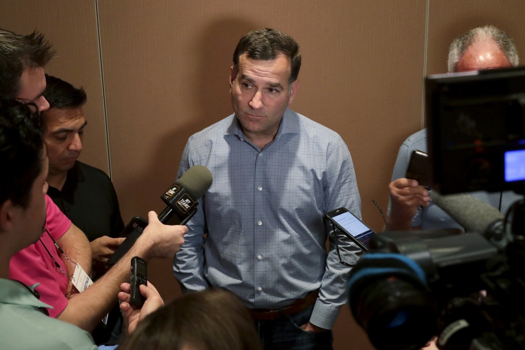 FILE - In this Nov. 12, 2019, file photo, Chicago White Sox general manager Rick Hahn, center, speaks during a media availability at the Major League ...