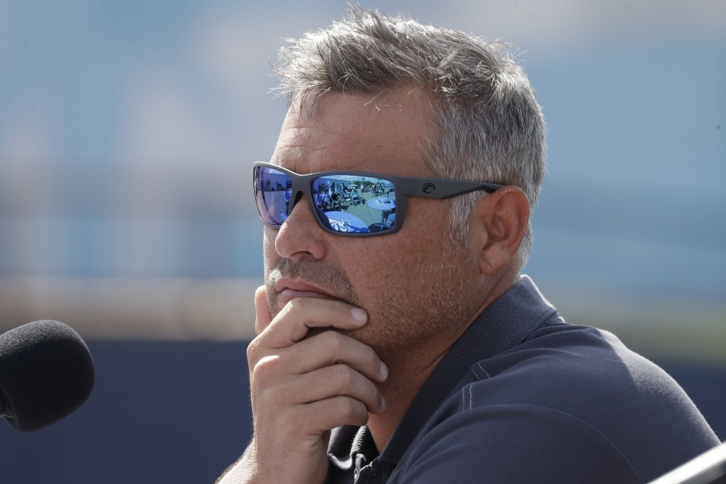 FILE - In this Feb. 12, 2020, file photo, Tampa Bay Rays manager Kevin Cash listens to a question during a news conference after pitchers and catchers...