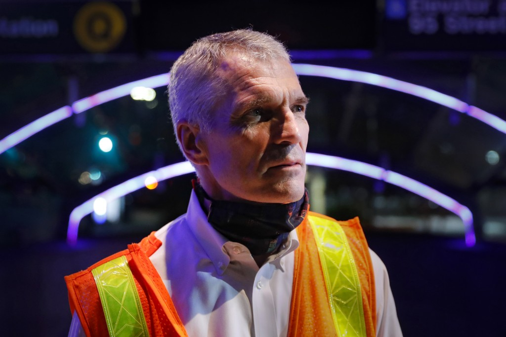 Patrick Warren, the MTA's chief safety officer, stands outside the 96th Street station as contractors below clean subway cars to control the spread of...