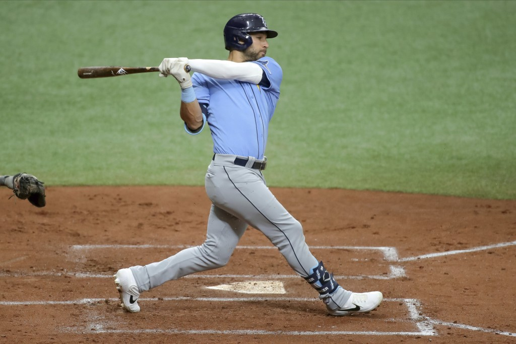 FILE - In this Saturday, July 11, 2020, file photo, Tampa Bay Rays' Kevin Kiermaier bats during baseball practice in St. Petersburg, Fla. (AP Photo/Mi...