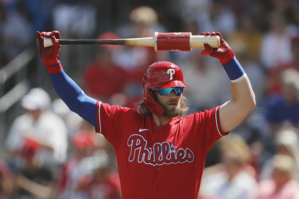 FILE - In this March 9, 2020, file photo, Philadelphia Phillies' Bryce Harper stretches during a spring training baseball game, in Clearwater, Fla. (A...