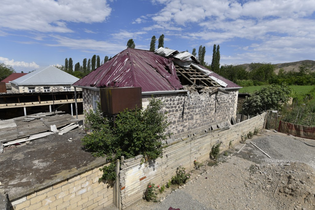 A damaged house is seen after shelling by Armenian forces in the Tovuz region of Azerbaijan, Tuesday, July 14, 2020. Skirmishes on the volatile Armeni...