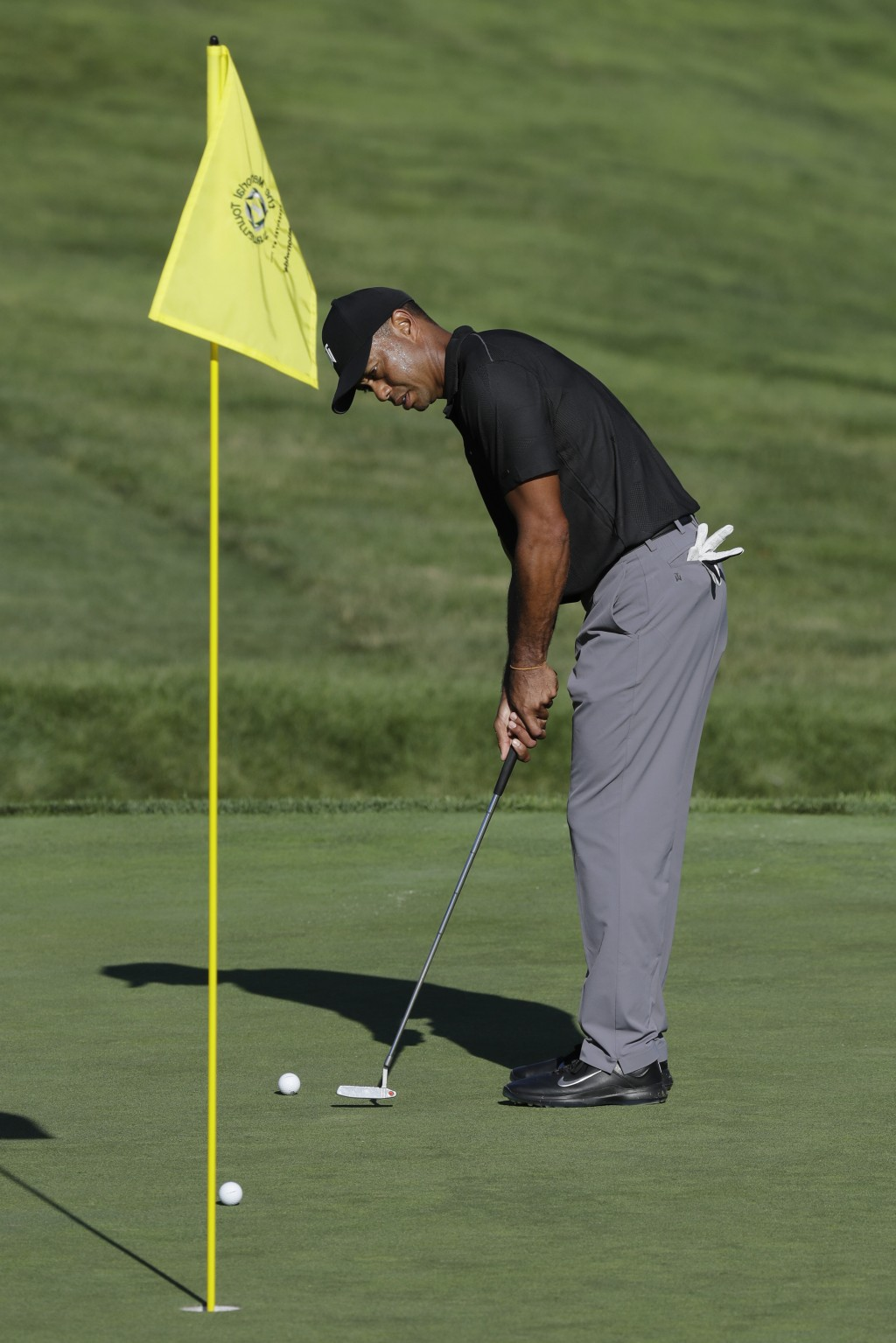 Tiger Woods putts on the 13th green during a practice round for the Memorial golf tournament, Tuesday, July 14, 2020, in Dublin, Ohio. (AP Photo/Darro...