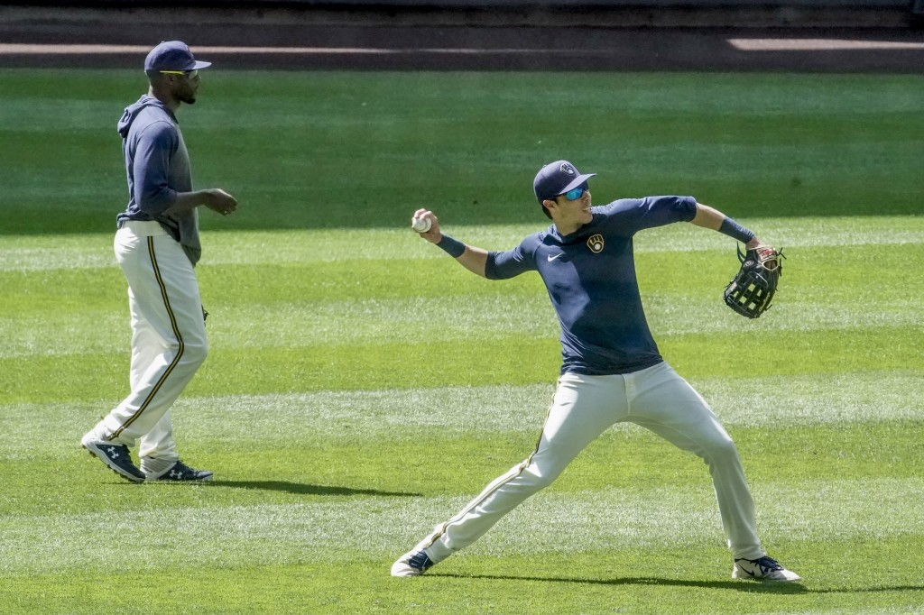 Milwaukee Brewers' Christian Yelich throws during a practice session Monday, July 13, 2020, at Miller Park in Milwaukee. (AP Photo/Morry Gash)