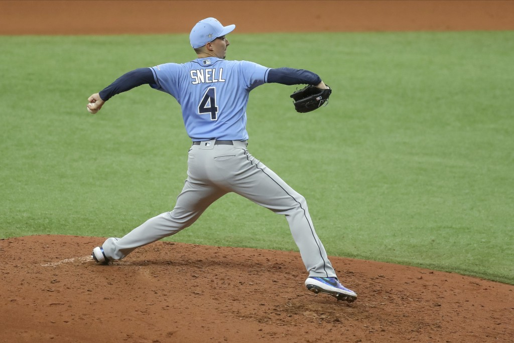 FILE - In this Wednesday, July 8, 2020, file photo, Tampa Bay Rays' Blake Snell throws during baseball practice in St. Petersburg, Fla. (AP Photo/Mike...
