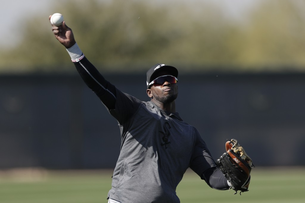 FILE - In this Monday, Feb. 17, 2020, file photo, Chicago White Sox center fielder Luis Robert throws the ball during spring training baseball in Phoe...