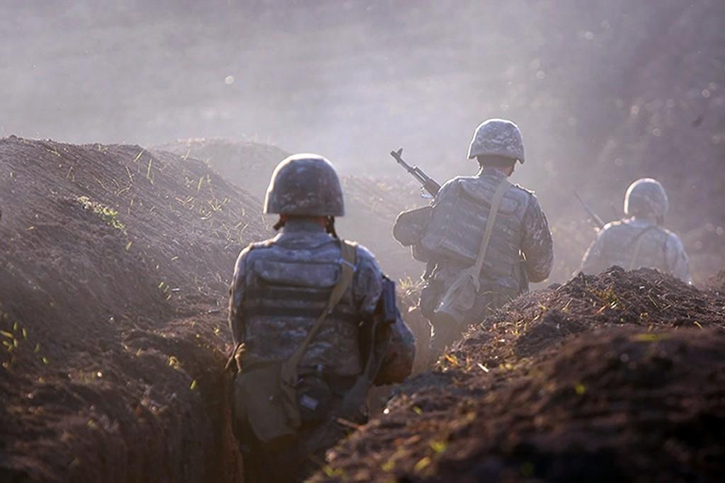 Armenian soldiers take their position on the front line in Tavush region, Armenia, Tuesday, July 14, 2020. Skirmishes on the volatile Armenia-Azerbaij...