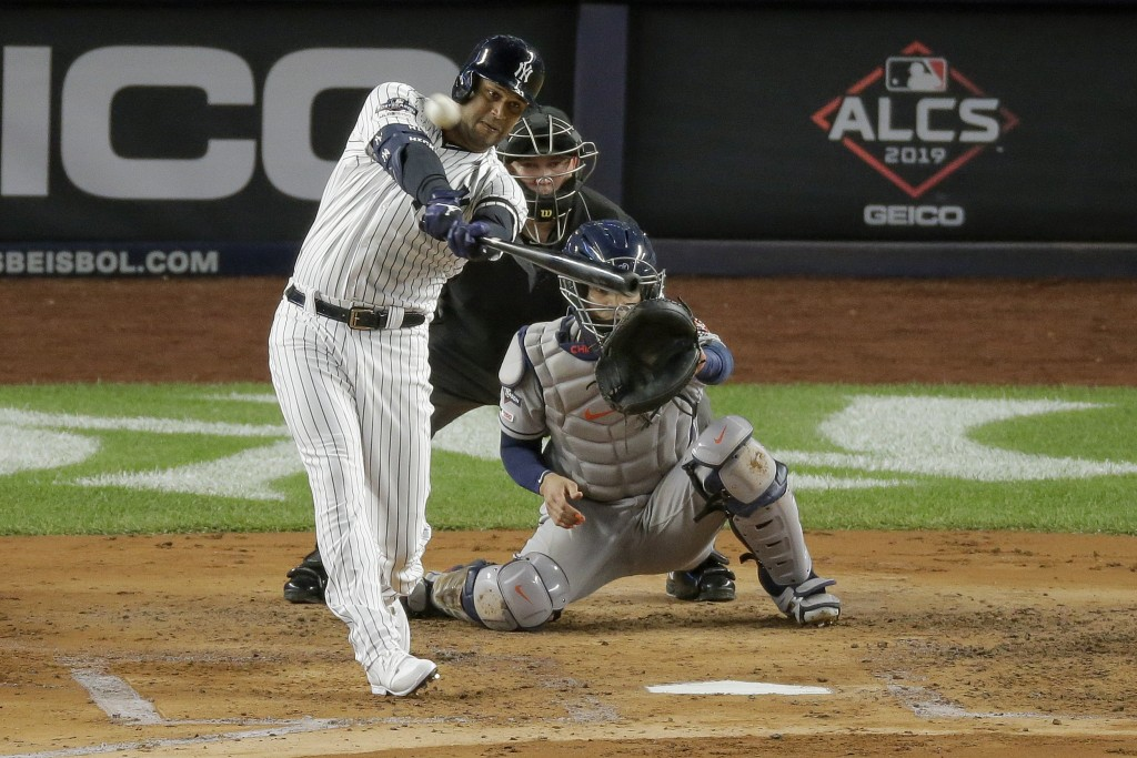 FILE - In this Oct. 18, 2019, file photo, New York Yankees' Aaron Hicks connects for a three-run home run against the Houston Astros during the first ...