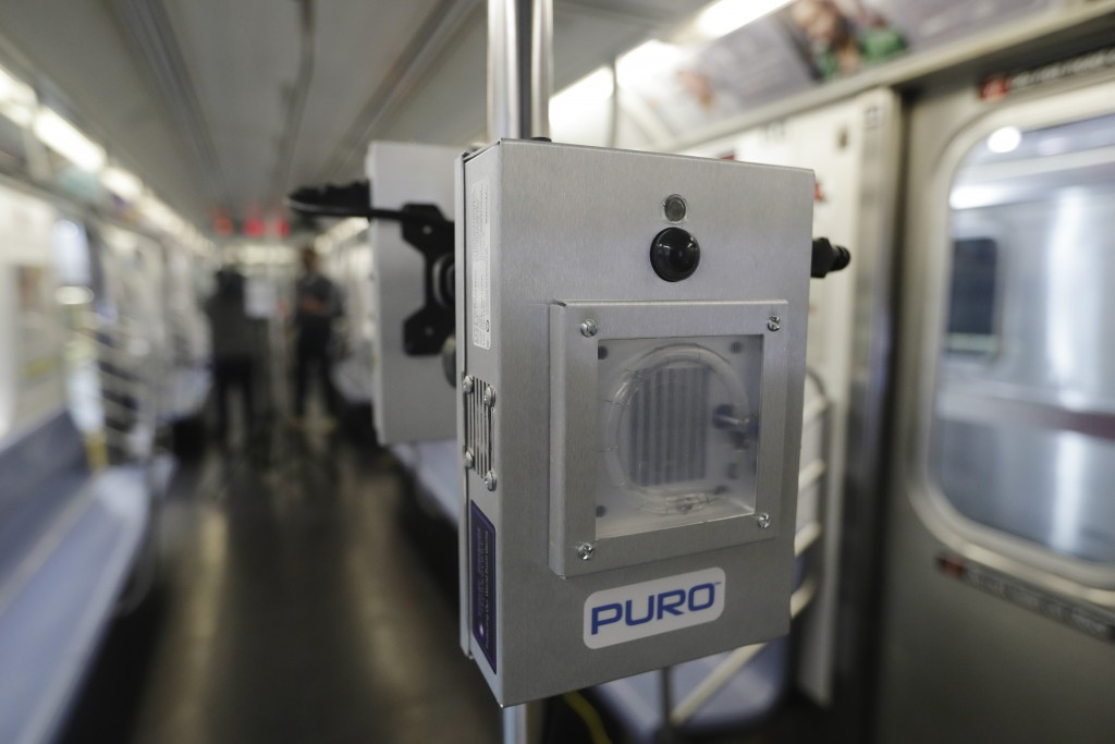 FILE - In this May 19, 2020, file photo, a UV-C lighting device to be used to disinfect trains and buses during the coronavirus pandemic is shown on a...