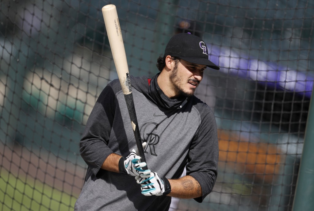 Colorado Rockies third baseman Nolan Arenado waits to step in the batting cage during the team's baseball practice Sunday, July 12, 2020, in Denver. (...