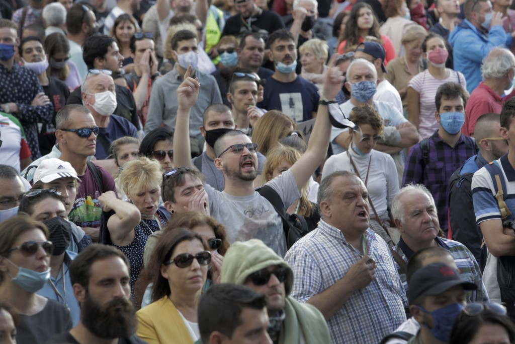 Protesters shout slogans as they take part in anti-governmental protest in downtown Sofia on Monday, July 13, 2020. Thousands of mostly young Bulgaria...