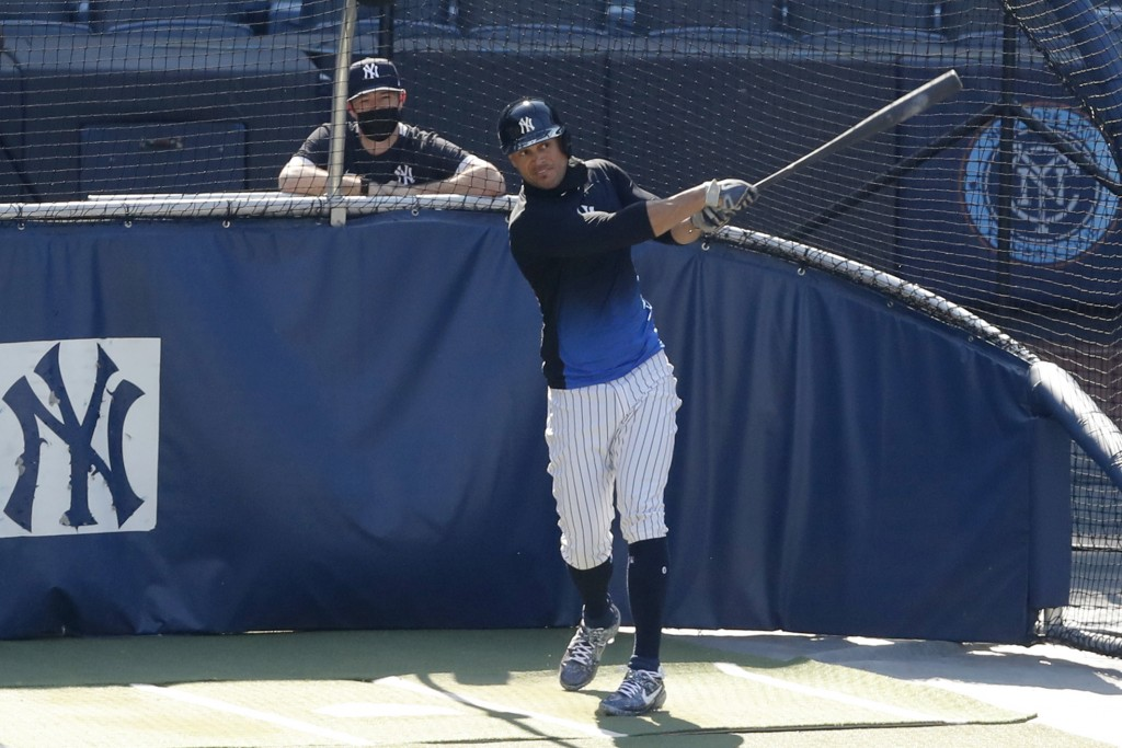 FILE - In this July 5, 2020, file photo, New York Yankees designated hitter Giancarlo Stanton bats during summer baseball training at Yankee Stadium i...
