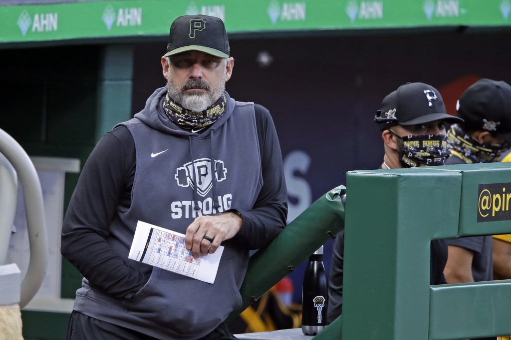 Pittsburgh Pirates manager Derek Shelton, left, stands on the dugout steps during the team's intrasquad baseball game at PNC Park in Pittsburgh, Monda...