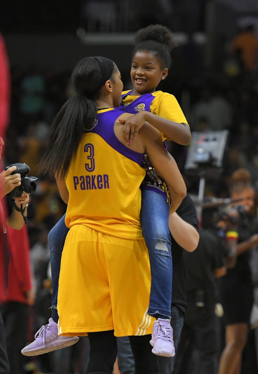 FILE- In this Sept. 29, 2017, file photo, Los Angeles Sparks forward Candace Parker holds her daughter Lailaa Nicole Williams after Game 3 of the WNBA...