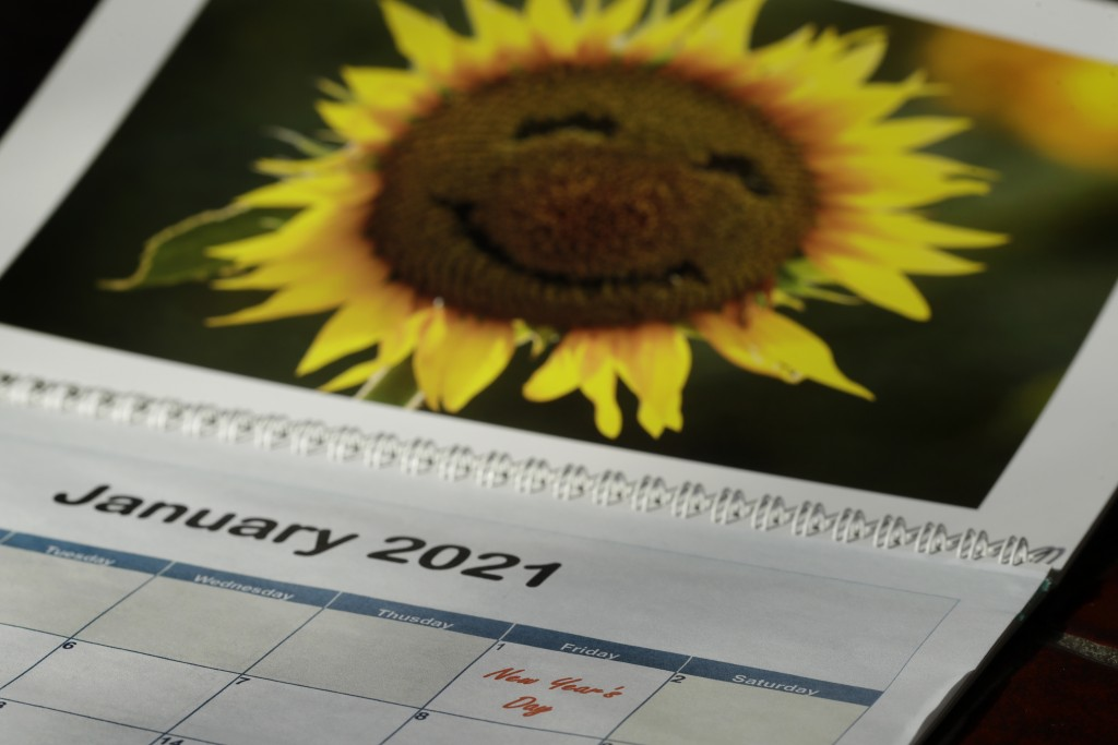 New Year's Day is seen on a 2021 calendar Friday, July 10, 2020, in Overland Park, Kan. 2020 is barely halfway over. That hasn't stopped many people f...