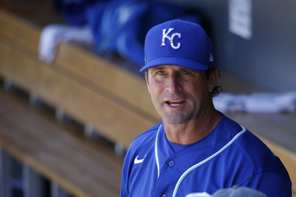 FILE - In this Monday, March 9, 2020, file photo, Kansas City Royals manager Mike Matheny pauses in the dugout prior to a spring training baseball gam...
