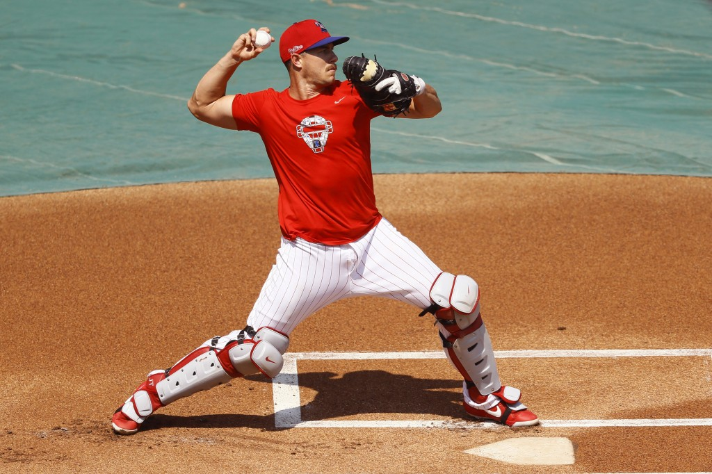 FILE - In this July 6, 2020, file photo, Philadelphia Phillies' J.T. Realmuto throws to second base during baseball practice at Citizens Bank Park in ...