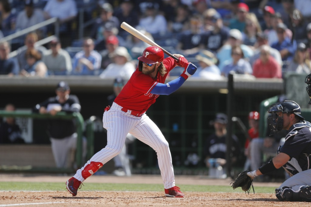 FILE - In this March 9, 2020, file photo, Philadelphia Phillies' Bryce Harper bats during a spring training baseball game in Clearwater, Fla. (AP Phot...