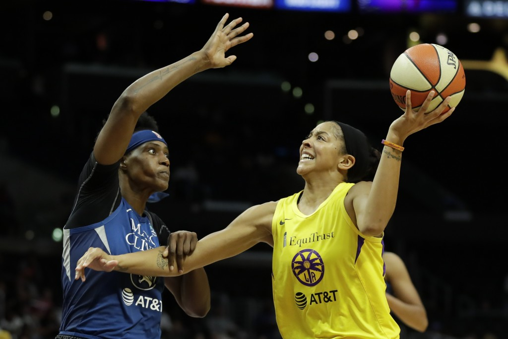 FILE - In this Aug. 20, 2019, file photo, Minnesota Lynx center Sylvia Fowles, left, fouls Los Angeles Sparks forward Candace Parker during the second...
