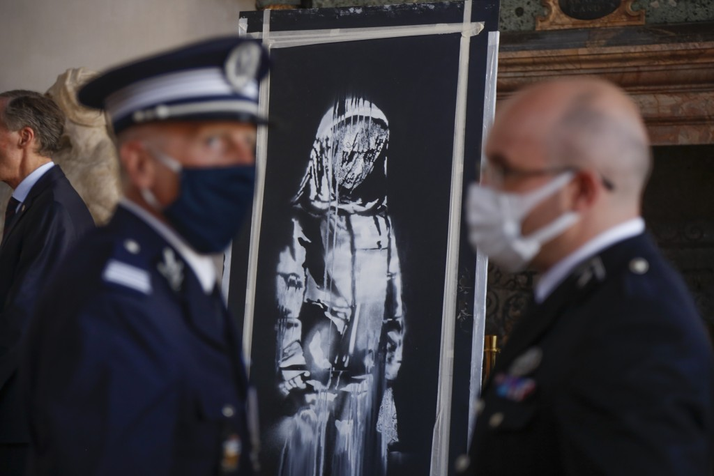A recovered stolen artwork by British artist Banksy, depicting a young female figure with a mournful expression, that was painted as a tribute to the ...