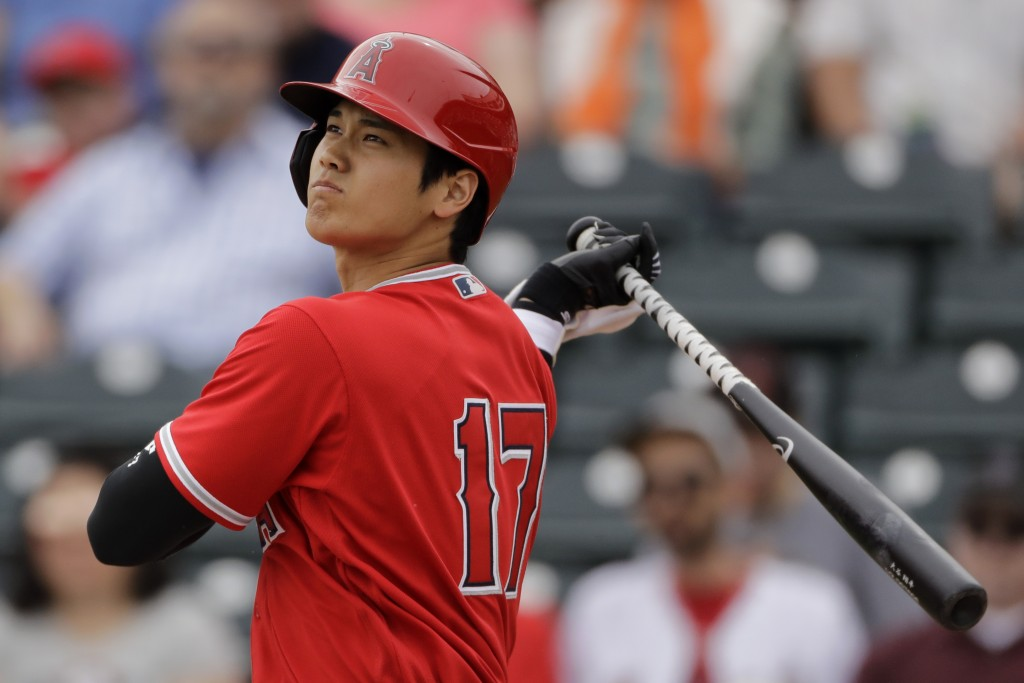 FILE - In this Feb. 28, 2020, file photo, Los Angeles Angels' Shohei Ohtani bats during the first inning of a spring training baseball game against th...