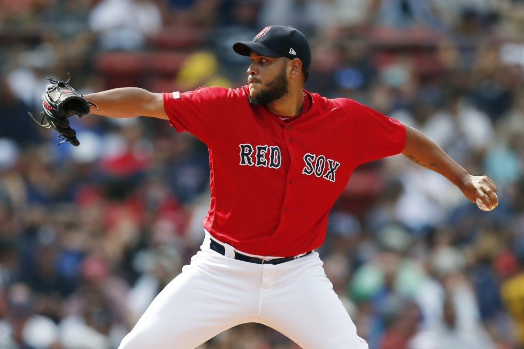 FILE - In this July 27, 2019, file photo, Boston Red Sox's Eduardo Rodriguez pitches during the first inning of a baseball game against the New York Y...