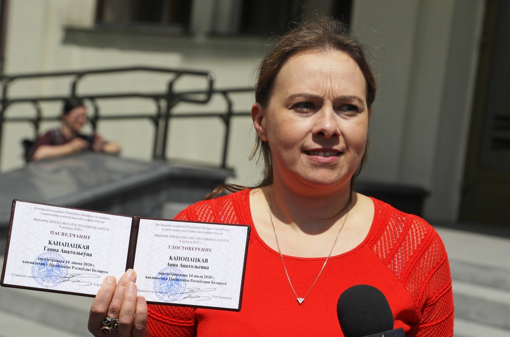 Anna Kanopatskaya shows her presidential candidate's identification card after she was registered as a candidate for the presidential elections in Min...