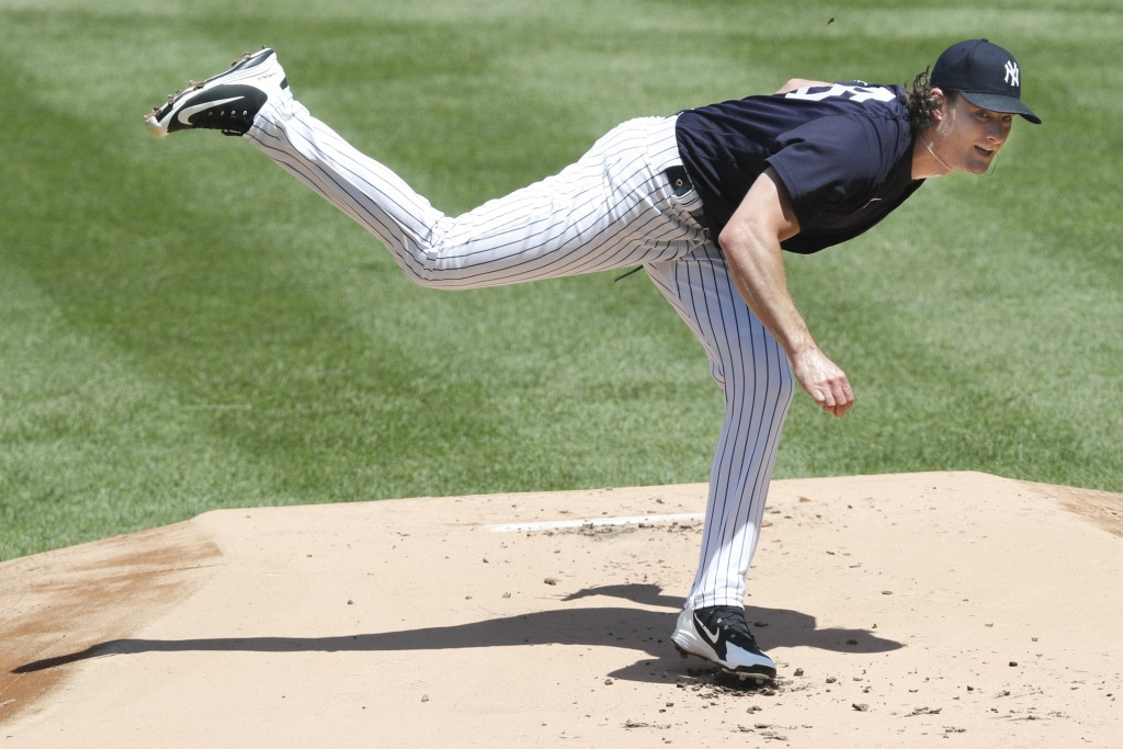 FILE - In this Sunday, July 12, 2020, file photo, New York Yankees starting pitcher Gerrit Cole follows through on a pitch during an intrasquad baseba...