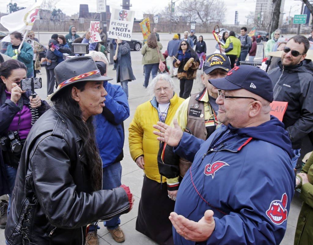 FILE - In this April 10, 2015, file photo, Philip Yenyo, left, executive director of the American Indians Movement for Ohio, talks with a Cleveland In...