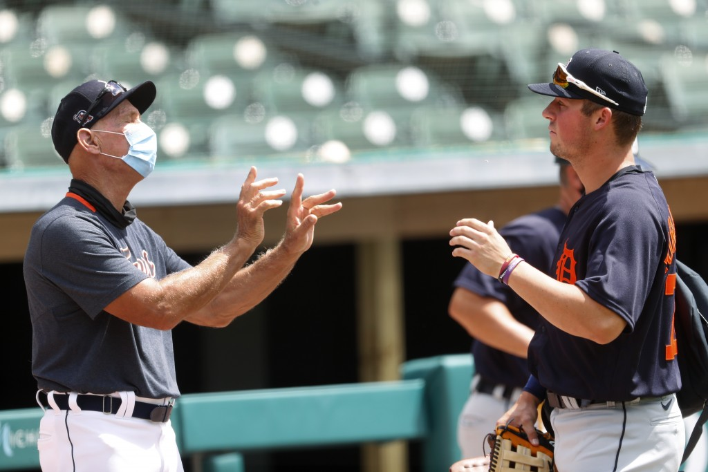 Detroit Tigers' Alan Trammel, special assistant to the general manager, left, talks with Spencer Torkelson after an intrasquad baseball game in Detroi...