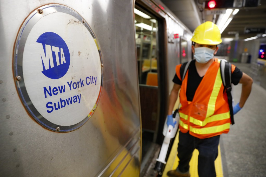 Contractors clean subway cars at the 96th Street station to control the spread of COVID-19, Thursday, July 2, 2020, in New York. Mass transit systems ...